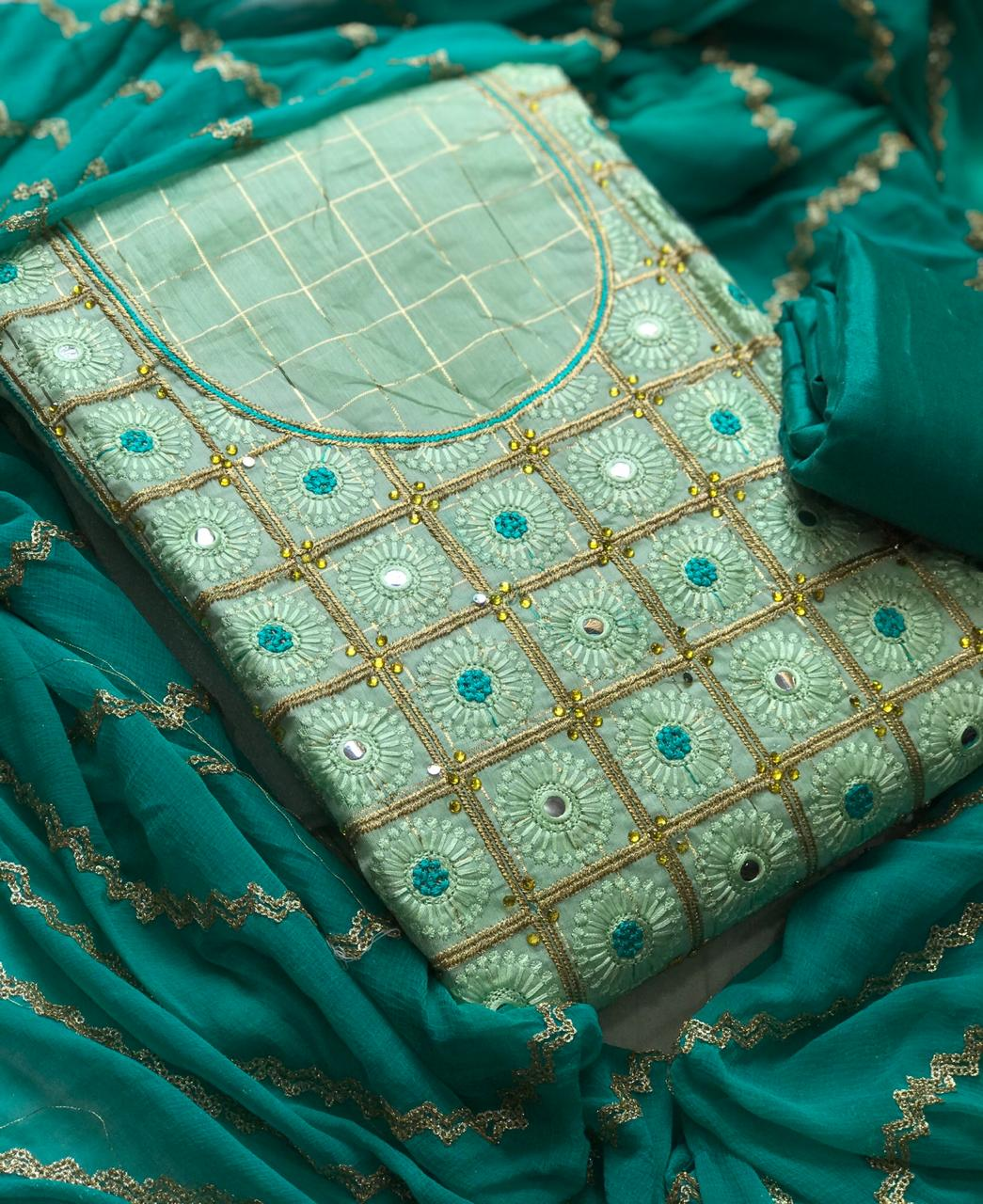 Thankar Designer Semi Modar Chex With Embroidery Work Dress Material Catalog at Wholesale rate
