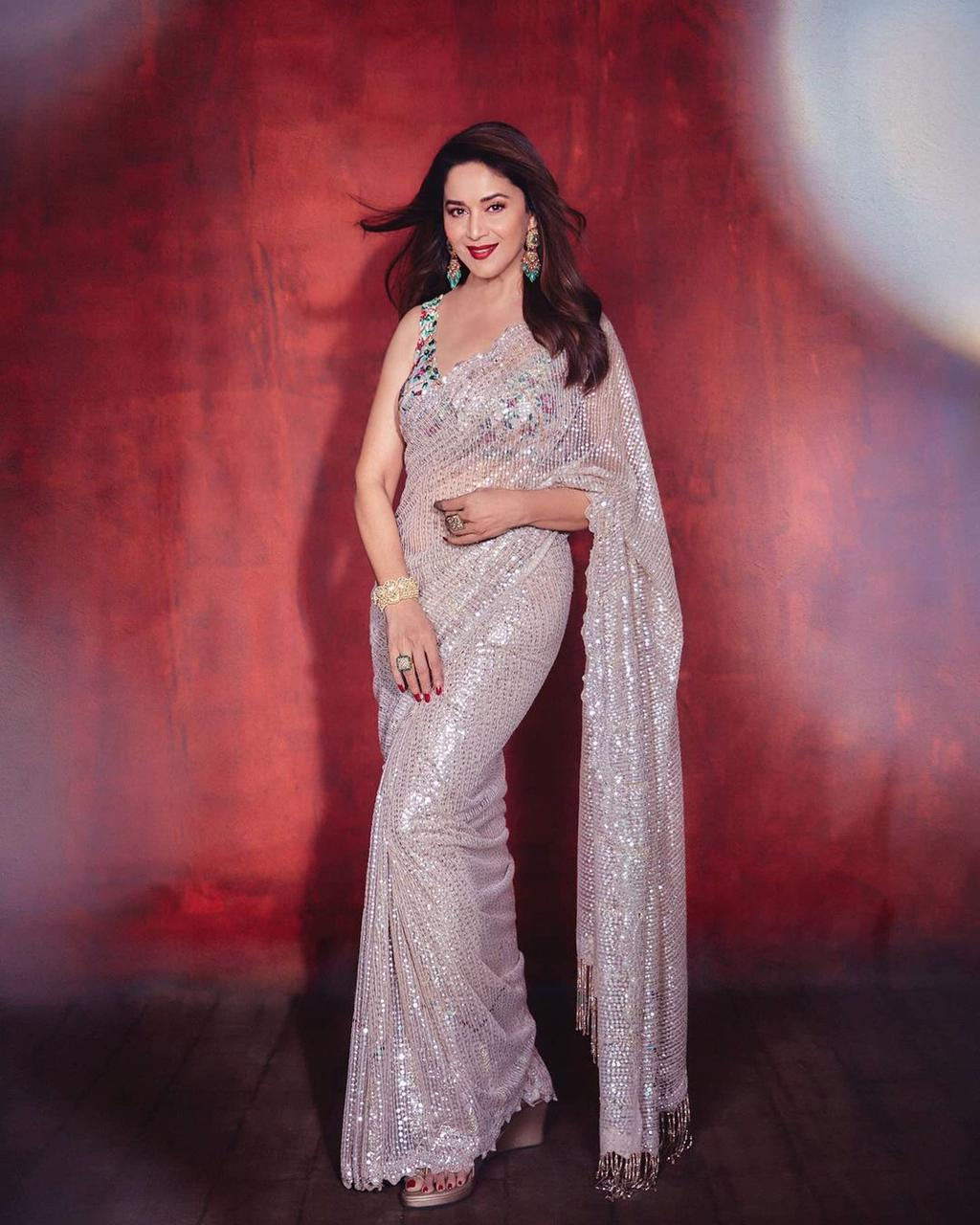 Fancy Designer Zari Net Fabric With Beautiful Sequence Saree At Wholesale Rate
